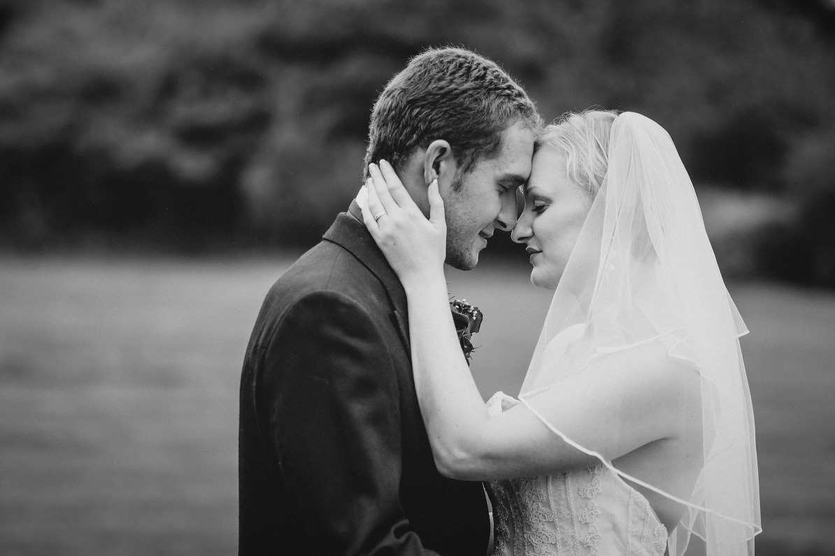Bride and groom together in black and white