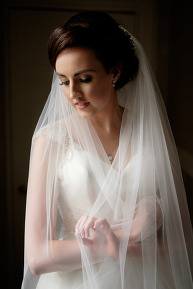 The bride wrapping her veil around herself